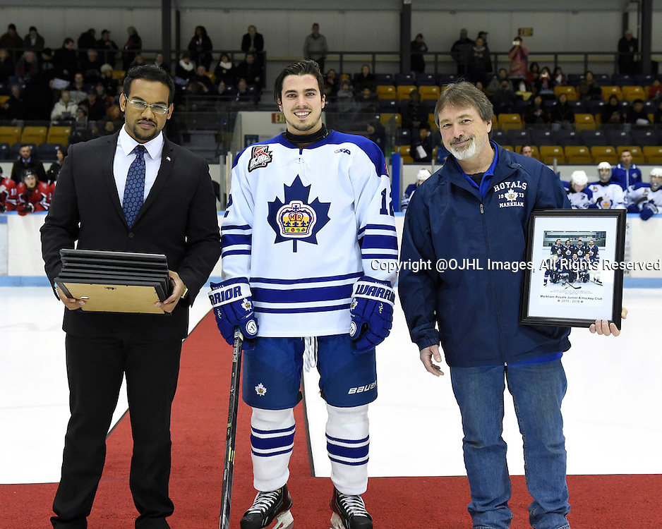 MARKHAM, - Feb 26, 2016 -  Ontario Junior Hockey League game action between Stouffville and Markham at the Markham Centennial Community Centre, ON. Jason O'Connor #12 of the Markham Royals with Anil Sukul Special Assistant to MP Bob Saroya and Mark Mothersill from the Markham Royals during a special pre-game ceremony.<br /> (Photo by Andy Corneau / OJHL Images)