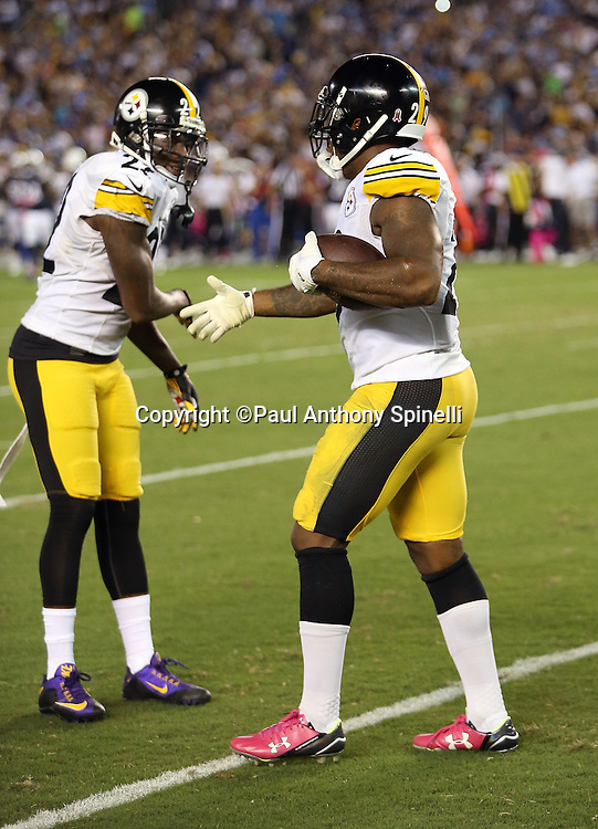 Pittsburgh Steelers strong safety Shamarko Thomas (29) gets a low five from Pittsburgh Steelers cornerback Senquez Golson (27) after Thomas recovers a third quarter fumble by the San Diego Chargers near mid-field during the 2015 NFL week 5 regular season football game against the San Diego Chargers on Monday, Oct. 12, 2015 in San Diego. The Steelers won the game 24-20. (©Paul Anthony Spinelli)
