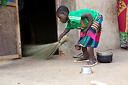Balila sweeping the compound at her home in Tinguri, Ghana.