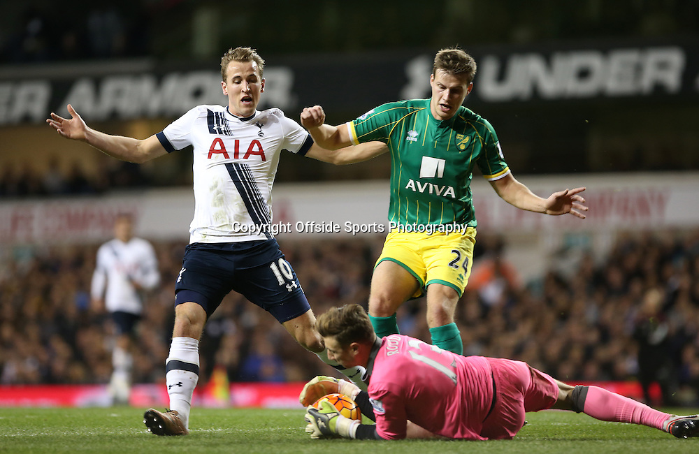 26 December 2015 - Premier League - Tottenham Hotspur v Norwich City<br /> Norwich goalkeeper Declan Rudd takes possession of the ball, stopping Harry Kane of Spurs and Ryan Bennett of Norwich in their tracks<br /> Photo: Charlotte Wilson / Offside