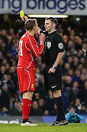 Lucas Leiva of Liverpool is booked during the Capital One Cup Semi Final 2nd Leg match between Chelsea and Liverpool at Stamford Bridge, London, England on 27 January 2015. Photo by David Horn.