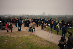 Primrose Hill, London, March 20th 2015. Scores of Londoners hoping for a break in the clouds, gather on Primrose Hill in North London, to view the solar eclipse.