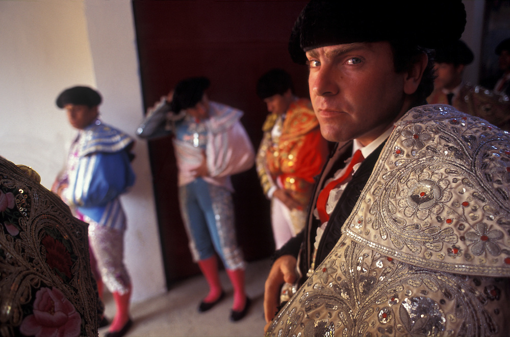 A bullfighter, or matador, glances aside before entering the bullring to meet his adversary at Medellin's Plaza de Toros.