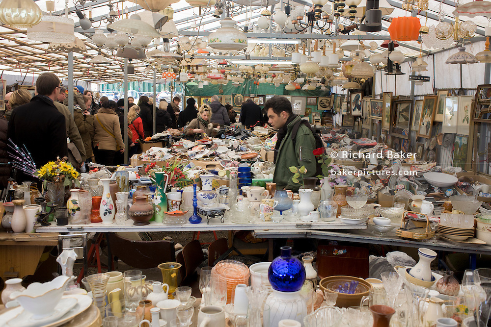 Glassware, crockery, bric-a-brac and old possessions being sold at a giant market in Mauerpark - an open space on the site of the old Berlin wall, the former border between Communist East and West Berlin during the Cold War.
