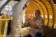 Installation of door hardware during final assmebly process of a Boeing 737 at Boeing Renton plant, Renton Washington