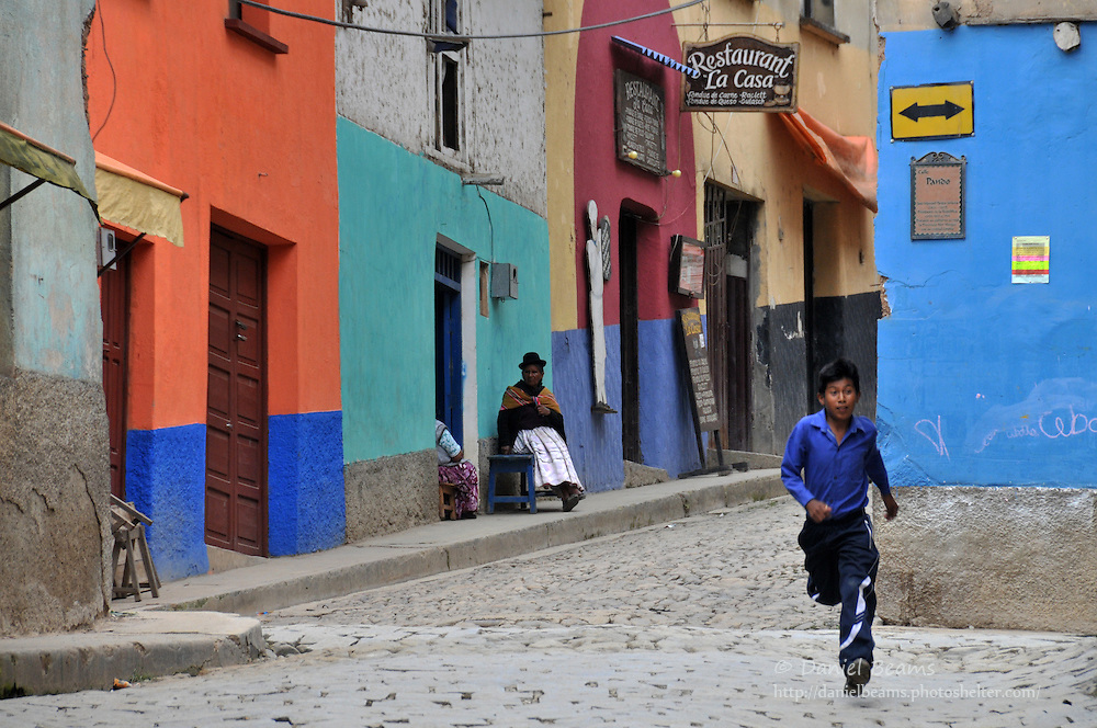 Boy running in the streets of Coroico, Bolivia