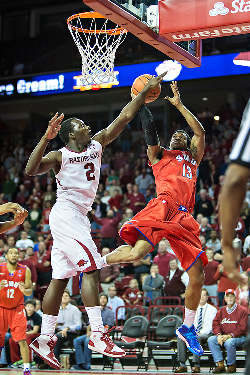 FAYETTEVILLE, AR - NOVEMBER 18:  Crandall Head #13 of the SMU Mustangs has his shot blocked by Alandise Harris #2 of the Arkansas Razorbacks at Bud Walton Arena on November 18, 2013 in Fayetteville, Arkansas.  The Razorbacks defeated the Mustangs 89-78.  (Photo by Wesley Hitt/Getty Images) *** Local Caption *** Alandise Harris; Crandall Head