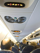 Overhead warning lights in an commercial airplane.