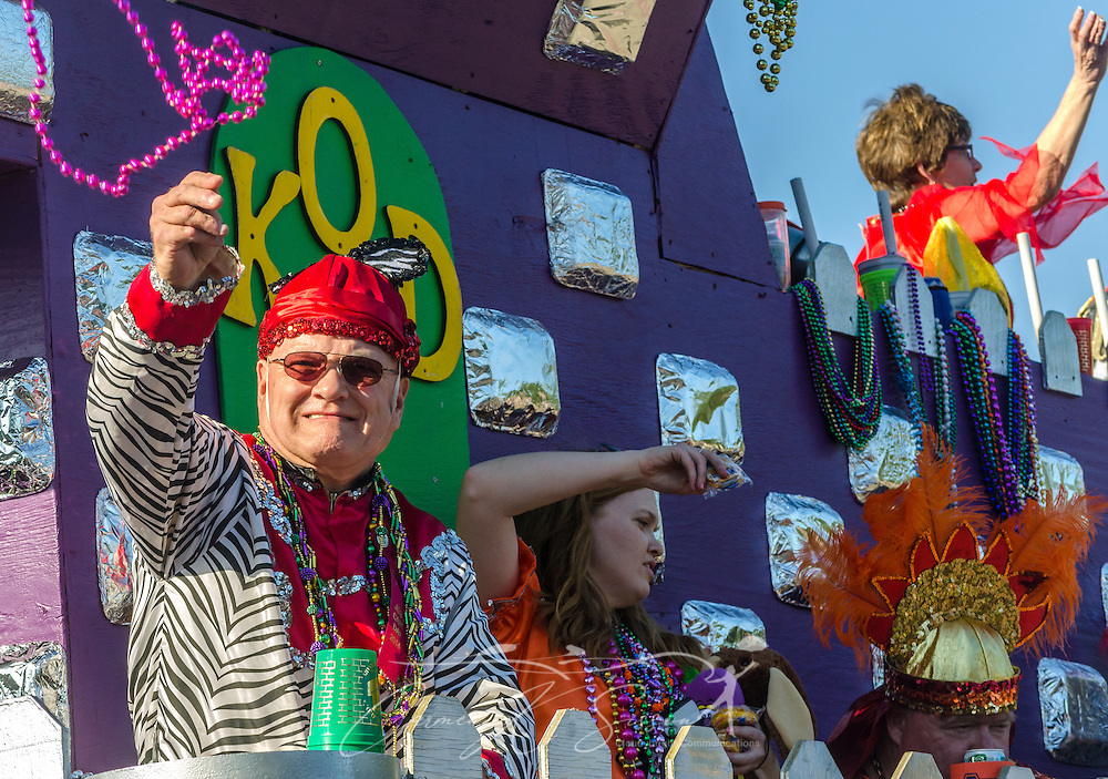 Members of the Knights of Daze throw beads to the crowd as his float travels down Canal Street in downtown Mobile, Ala., during the Joe Cain Procession at Mardi Gras, March 2, 2014. French settlers held the first Mardi Gras in 1703, making Mobile's celebration the oldest Mardi Gras in the United States. (Photo by Carmen K. Sisson/Cloudybright)