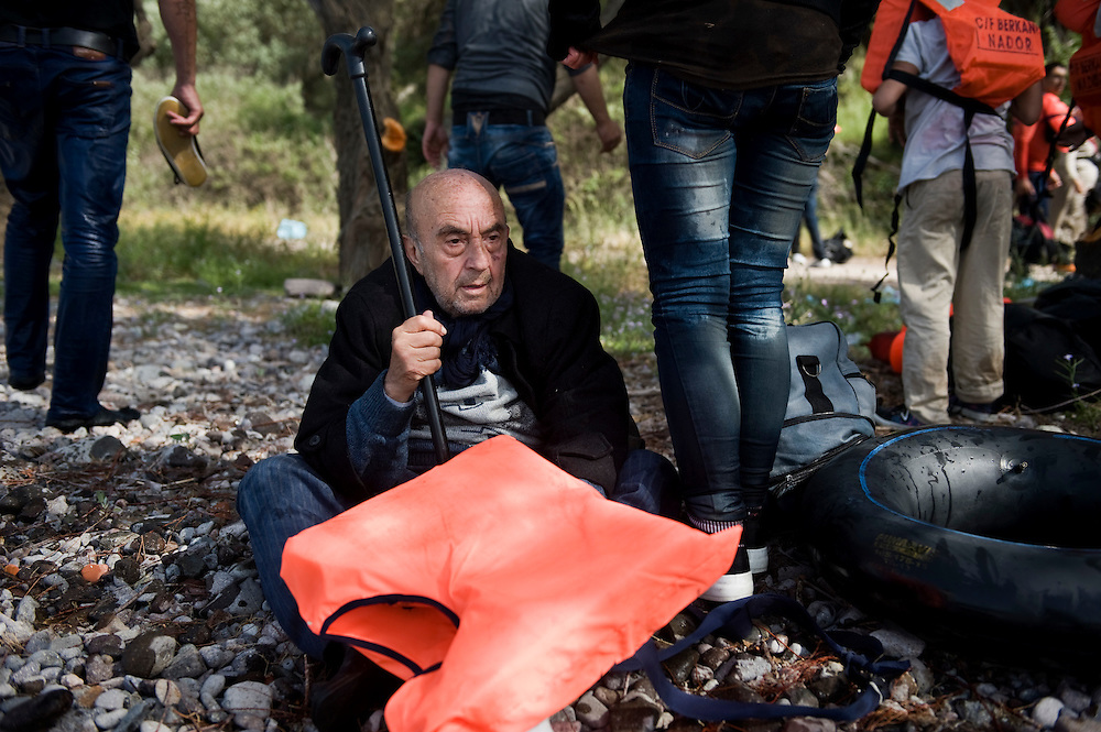 A disabled Syrian in his 70's resting in his walking stick after he disembark from a boat that brought him to Europe. Everyday hundreds of refugees, mainly from Syria and Afghanistan, are crossing in small overcrowded inflatable boats the 6 mile channel from the Turkish coast to the island of Lesbos in Greece. Many spend their life savings, over $1000, to buy a space on those boats.