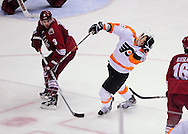 Dec. 3 2011; Glendale, AZ, USA; Phoenix Coyotes defensemen Keith Yandle (3) tried to clear the puck as Philadelphia Flyers forward Zac Rinaldo  (36) gets hit in the face with the puck during the third period at Jobing.com Arena. The Flyers defeated the Coyotes 4-2. Mandatory Credit: Jennifer Stewart-US PRESSWIRE
