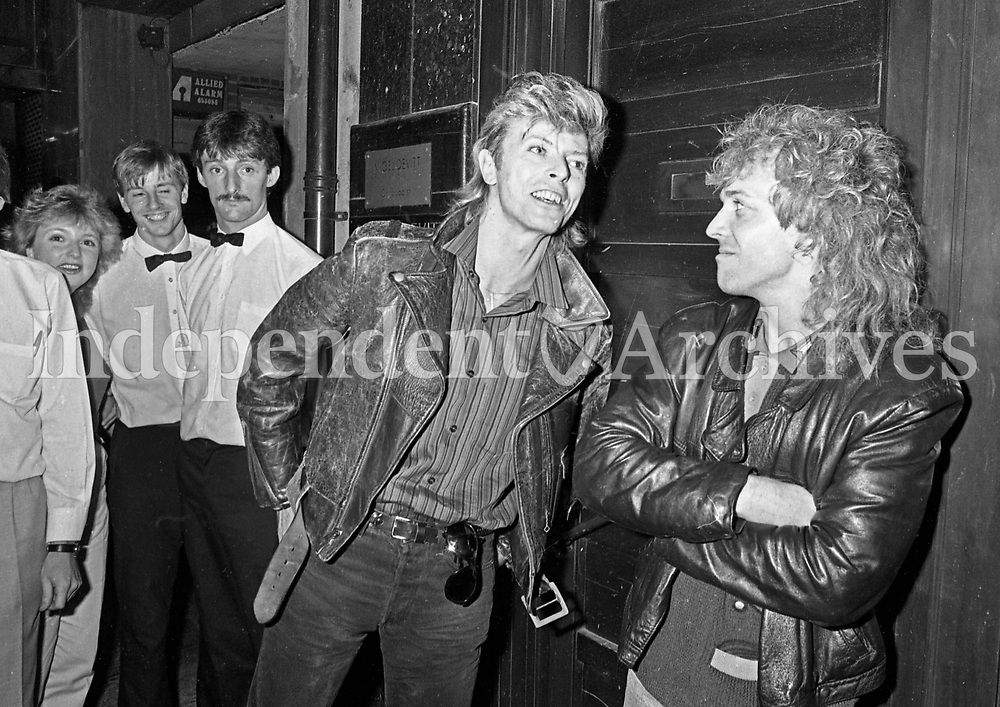 David Bowie and Peter Frampton leaving Caspar and Gambini's restaurant. <br />