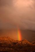 A rainbow develops over the Santa Catalina Mountains, Sonoran Desert, Coronado National Forest, Oro Valley, Arizona, USA.