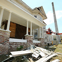Wooten Construction crews work to replace the old rotten siding from the Spain House in Tupelo on Thursday.