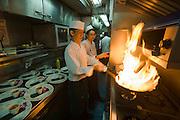 Eastern & Oriental Express. Sous-Chefs firing up the wok.