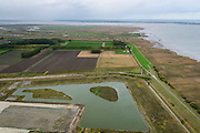 Nederland, Zeeland, Zeeuws-Vlaanderen, 23-10-2013; Van beneden naar boven: Belgische Prosperpolder en reeds onder water gezet, daarachter De Hedwige Polder en tenslotte Het Verdronken Land van Saeftinge aan het water van de Westerschelde.<br /> Borderland Belgium and the Netherlands, the Drowned Land Saeftinge (top) and the Belgian polder (bottom), under water due to environmental compensation. Westerschelde end entrance of the port of Antwerp (right).<br /> luchtfoto (toeslag op standaard tarieven);<br /> aerial photo (additional fee required);<br /> copyright foto/photo Siebe Swart.