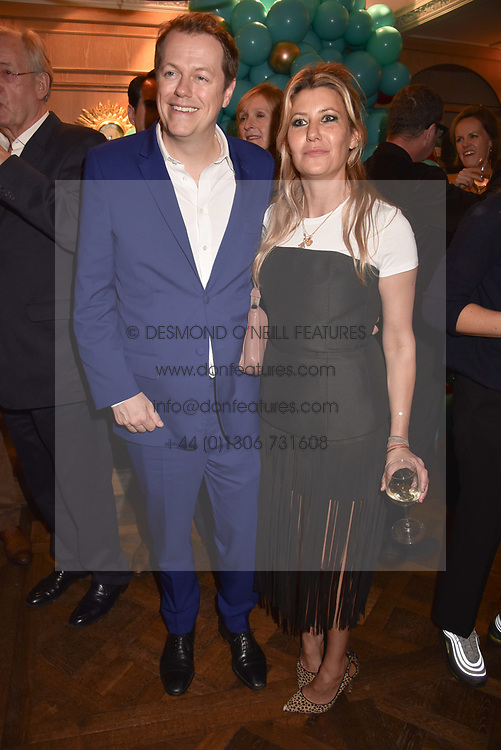 Tom Parker Bowles and his wife Sara at the launch of the Fortnum & Mason Christmas & Other Winter Feasts Cook Book by Tom Parker Bowles held at Fortnum & Mason, 181 Piccadilly, London, England. 17 October 2018.