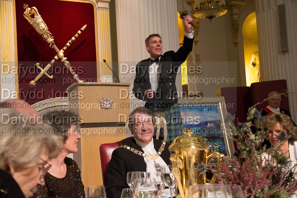 AUCTIONEER CHARLES GRAHAM CAMPBELL; ABOVE; THE LORD MAYOR OF LONDON, The National Trust for Scotland Mansion House Dinner. Mansion House, London. 16 October 2013