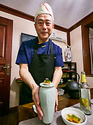 China, Sichuan. Chengdu. Yu Zhi Lan gourmet restaurant. Chef Lan Guijun serving a special with the after dinner tea.