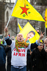 © Licensed to London News Pictures. 14/03/2018. London, UK. Pro-Kurdish demonstrators protest against Turkish oppression of Kurds and the bombing of Afrin, Northern Syria, by blocking the road on Parliament Square. The road was blocked for approximately two hours. Photo credit : Tom Nicholson/LNP