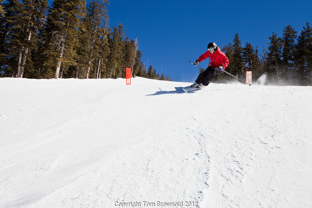 Woman skiers skiing on a sunny hard packed day