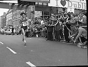 Finish of Dublin City Marathon .25/10/1982  Radio 2, Dublin City Marathon..1982.25.10.1982.10.25.1982.25th October 1982..The Radio 2 sponsored Dublin City Marathon finish at St Stephens Green Dublin..The overall winners were:Men, Gerry Kiernan,Listowel, Kerry. Women, Debbie Mueller,U.S.A. and the first wheelchair competitor Michael O'Rourke..Gerry Kiernan looking remarkably fresh crosses the finish line