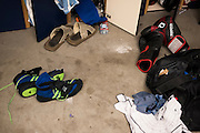 Training gear scattered on the ground in the locker room at Jackson Wink MMA in Albuquerque, New Mexico on June 10, 2016.