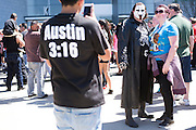 Fans take a photo with a Sting impersonator outside WrestleMania on April 3, 2016 in Arlington, Texas.