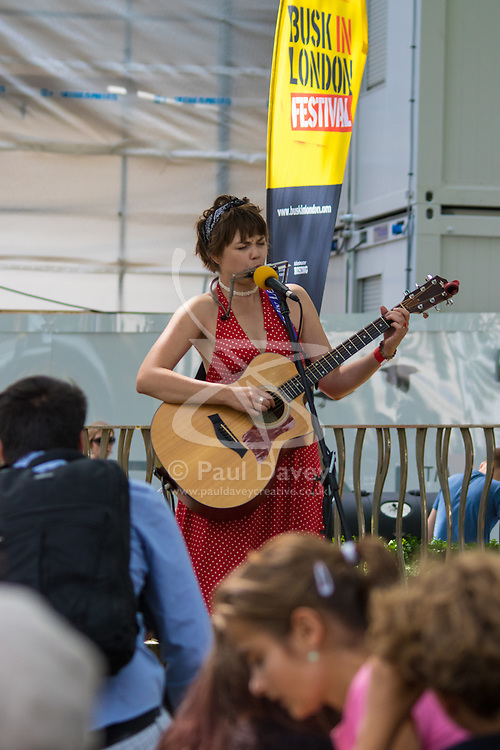 """London, July 18th 2015. Up and coming singer/songwriter Emily Lee perfoms a mixture of covers and self-penned songs from her recently released EP """"Don't Forget To Love"""" in Leicester Square as part of the Busk in London Festival aimed at showcasing the outstanding talents of many of the capital's finest street performers, including, musicians, magicians, living statues, jugglers and bands."""