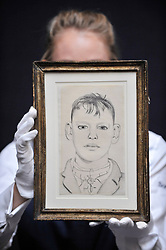 "© Licensed to London News Pictures. 06/10/2017. London, UK. A technician presents ""Boy on the Stairs"", 1948, by Lucien Freud at a preview at Sotheby's in New Bond Street of contemporary, impressionist and modern art works to be auctioned in New York in November 2017 Photo credit : Stephen Chung/LNP"