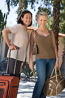Two women with luggage on vacation, portrait