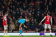 Sandro Scharer (Referee) marks out a line looked on by Hector Bellerin (Capt) (Arsenal) during the Europa League match between Arsenal and Standard Liege at the Emirates Stadium, London, England on 3 October 2019.