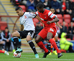 Leyton Orient's Marvin Bartley tussles for the ball with Swindon Town's Massimo Luongo - photo mandatory by-line David Purday JMP- Tel: Mobile 07966 386802 - 04/10/14 - Leyton Orient  v Swindon Town - SPORT - FOOTBALL - Sky Bet Leauge 1  - London -  Matchroom Stadium