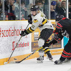 TRENTON, ON  - MAY 5,  2017: Canadian Junior Hockey League, Central Canadian Jr. &quot;A&quot; Championship. The Dudley Hewitt Cup. Game 7 between The Georgetown Raiders and The Powassan Voodoos.  Tyson Gilmour #23 of the Powassan Voodoos plays the puck during the first period <br /> (Photo by Amy Deroche / OJHL Images)