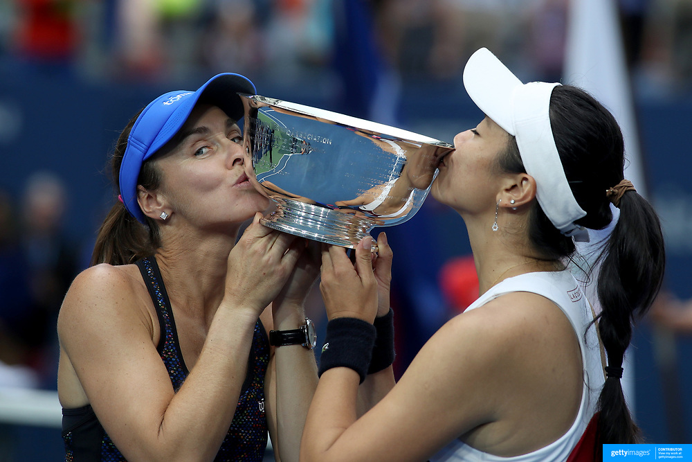 2017 U.S. Open Tennis Tournament - DAY FOURTEEN. Martina Hingis of Switzerland and Yung-Jan Chan of Chinese Taipei with the trophy after winning the Women's Doubles Final at the US Open Tennis Tournament at the USTA Billie Jean King National Tennis Center on September 10, 2017 in Flushing, Queens, New York City.  (Photo by Tim Clayton/Corbis via Getty Images)