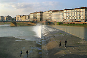 People walking by the dam across the river Arno in central Florence, Italy.