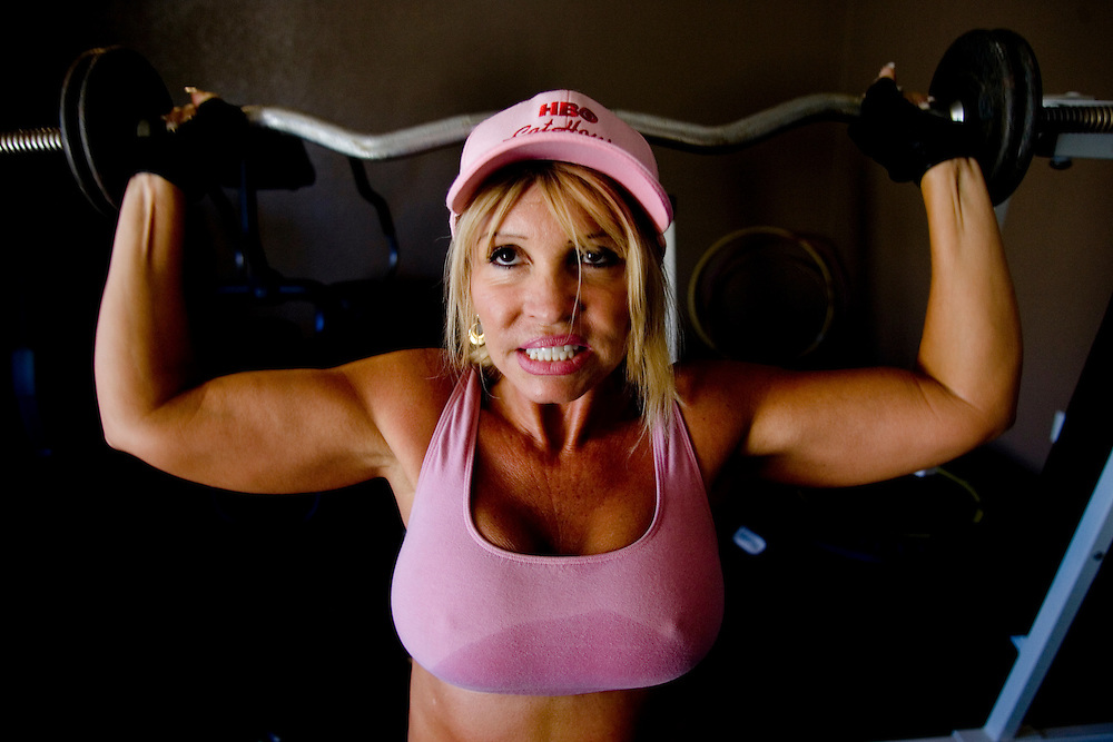 "Sex worker Felicia Foxxx works out in the gym of the Moonlite Bunny Ranch brothel in Mound House, NV on Friday, July 28, 2006. The Moonlite Bunny Ranch brothel in Mound House, Nevada, just a few miles from the state capital in Carson City, first opened in 1955. The Ranch is a legal, licensed brothel owned by Dennis Hof. It's featured in the HBO series ""Cathouse."""