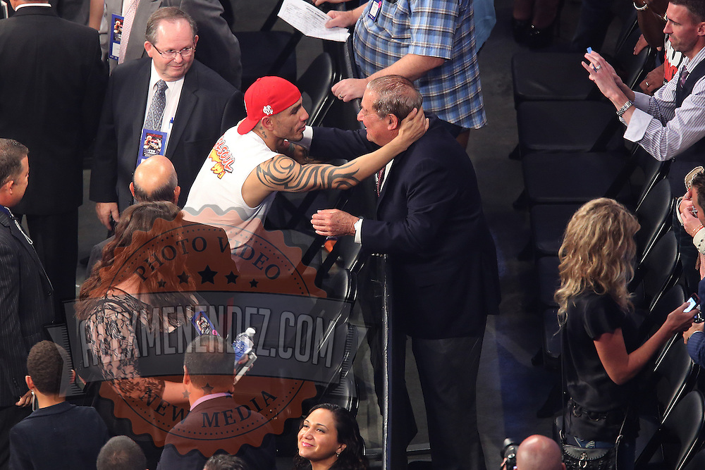 Miguel Cotto of Puerto Rico hugs boxing promoter Bob Arum at the Amway Center in Orlando, Florida on Saturday, October 5, 2013. Cotto beat Delvin Rodriguez by knockout in the 3rd round of the match.(Photo/Alex Menendez)