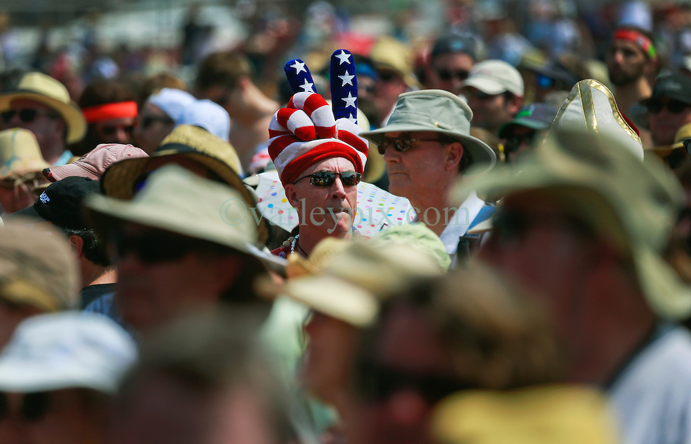 25 April 2014. New Orleans, Louisiana.<br /> A man wearing a patriotic hat amongst crowds at the New Orleans Jazz and Heritage Festival. <br /> Photo; Charlie Varley/varleypix.com