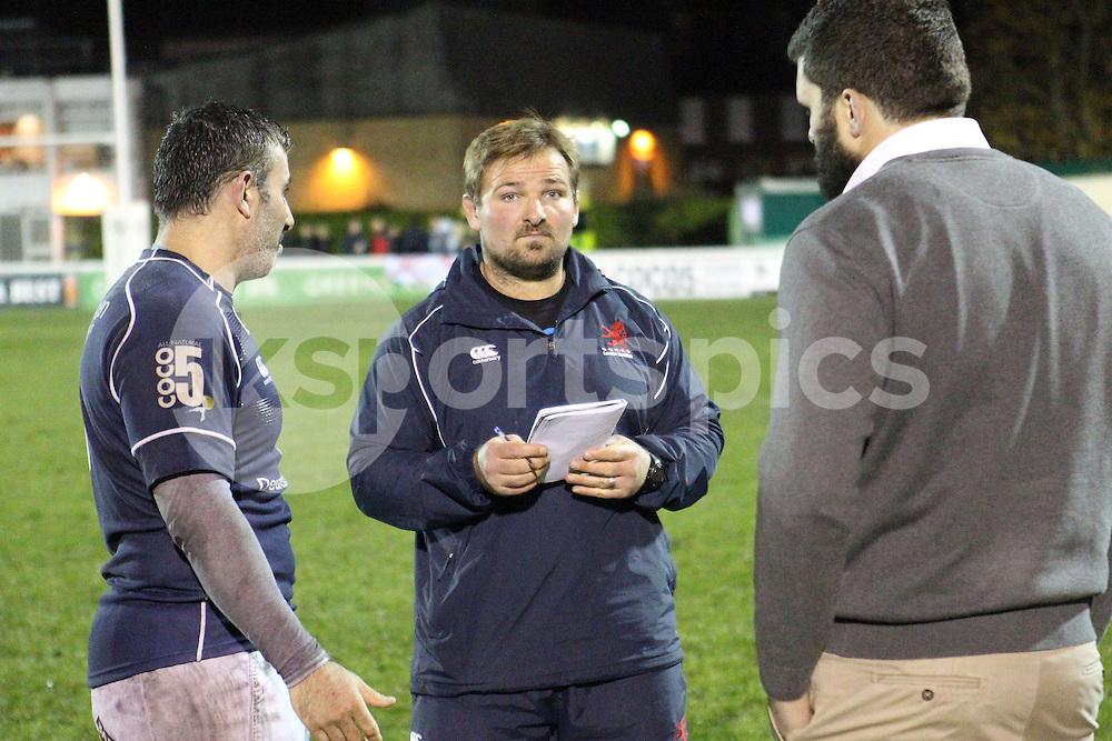 Coach James Buckland makes notes after the Green King IPA Championship match between London Scottish &amp; Jersey at Richmond, Greater London on Friday 14th November 2014<br /> <br /> Photo: Ken Sparks | UK Sports Pics Ltd<br /> London Scottish v Jersey, Green King IPA Championship,14th November 2014<br /> <br /> &copy; UK Sports Pics Ltd. FA Accredited. Football League Licence No:  FL14/15/P5700.Football Conference Licence No: PCONF 051/14 Tel +44(0)7968 045353. email ken@uksportspics.co.uk, 7 Leslie Park Road, East Croydon, Surrey CR0 6TN. Credit UK Sports Pics Ltd