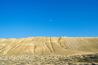 Desert hillside with blue sky and moon in Southeastern Washington USA.