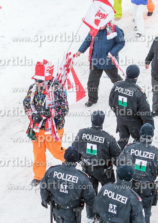 16.01.2016, Kulm, Bad Mitterndorf, AUT, FIS Skiflug WM, Kulm, im Bild Polizisten und Fans // an Austrian Fan walk throught Policemans during FIS Ski Flying World Championships at the Kulm in Bad Mitterndorf, Austria on 2016/01/16. EXPA Pictures © 2016, PhotoCredit: EXPA/ JFK