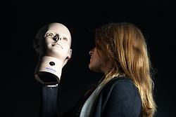 © Licensed to London News Pictures. 10/07/2019. Manchester, UK. A model of a human head, used to test doctors in the examination and diagnosis of eye conditions, is checked by the GMC's Kimberley Lees, ahead of the move. General Medical Council (GMC) staff prepare for the opening of the regulator's new test facility in central Manchester. The £2.5m clinical assessment centre in the city's Spinningfields district will assess the skills of overseas-trained doctors who want to work in the UK. Once it opens in early August, more than 1,000 doctors per month will undergo a series of practical tests to show they have the skills required for a licence to practise medicine in the UK. It will replace the GMC's existing test centre, which has a more limited capacity. Photo credit: Joel Goodman/LNP