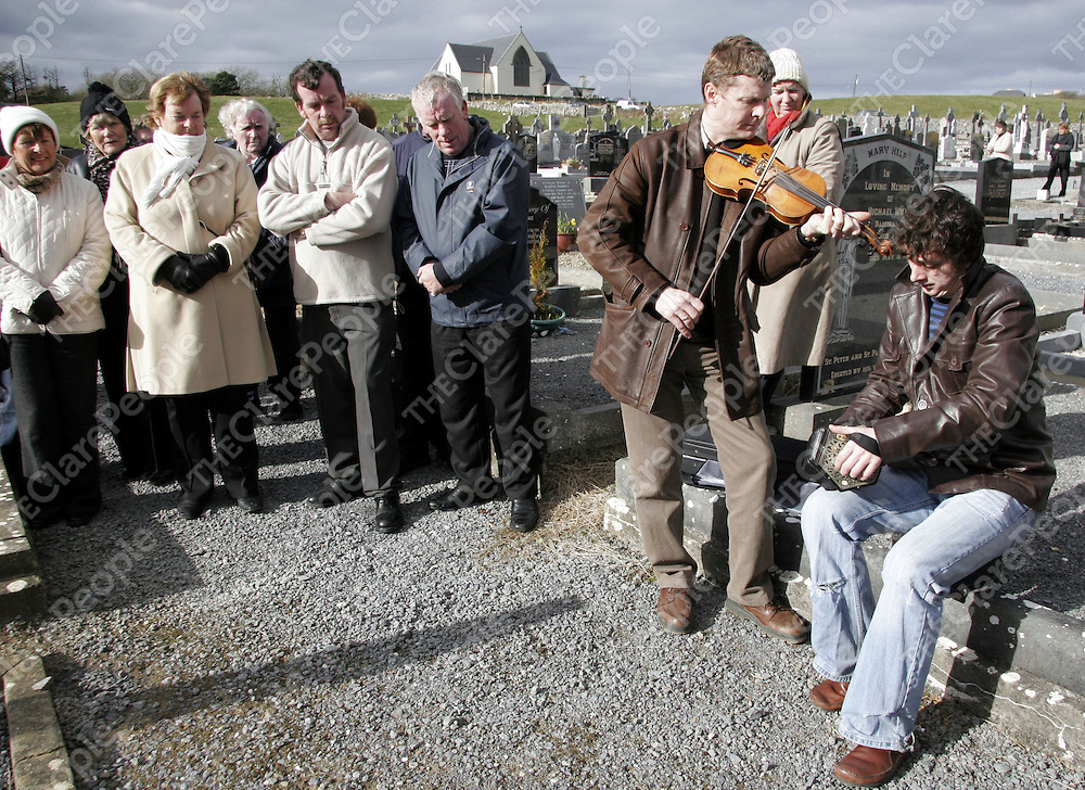 Musicians play tunes for the many people who tuned up at a memorial to the Russell brothers at Doolin graveyard on Sunday.<br />