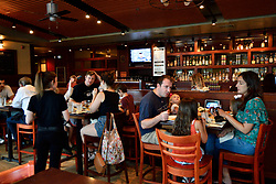 Families have lunch at the Iron Hill Brewery, in Phoenixville, PA, on August 21, 2018.
