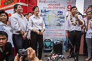 17 FEBRUARY 2013 - BANGKOK, THAILAND:  Thai Prime Minister YINGLUCK SHINAWATRA and PONGSAPAT PONGCHAREON campaign for governor of Bangkok in Bangkok Sunday. Pol General Pongsapat Pongcharoen, a former deputy national police chief who also served as secretary-general of the Narcotics Control Board is the Pheu Thai Party candidate in the upcoming Bangkok governor's election. (He resigned from the police force to run for Governor.) Former Prime Minister Thaksin Shinawatra reportedly recruited Pongsapat. Most of Thailand's reputable polls have reported that Pongsapat is leading in the race and likely to defeat Sukhumbhand Paribatra, the Thai Democrats' candidate and incumbent. The loss of Bangkok would be a serious blow to the Democrats, whose base is the Bangkok area.     PHOTO BY JACK KURTZ