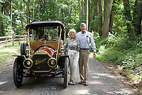 "9 July, 2008. Doylestow, PA. Jim Grundy, 54, and his mother Patricia in front of the 1909 Pierce Arrow antique car he owns.  Patricia Grundy sat in the back seat of this car at the age of 16, when her parents drove from Philadelphia to Detroit to participate at the Glidden Tour. Jim Grundy  is the chief executor of Grundy Worldwide, an insurance company for collectible cars. His father Jim Sr. Jr. started the business in 1947 and wrote the first antique car insurance policy in 1949. Jim Grundy has been in the business for 28 years and assumed major interest and the presidency 19 years ago. ""I own the best pre World War I cars ever manufactured"", Mr. Grundy says. <br /> <br /> ©2008 Gianni Cipriano for The Wall Street Journal<br /> cell. +1 646 465 2168 (USA)<br /> cell. +1 328 567 7923 (Italy)<br /> gianni@giannicipriano.com<br /> www.giannicipriano.com"