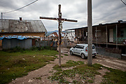 "A cross in the centre of the Roma part of the district ""Podsadek"". The town of Stara Lubovna has a population of 16350, of whom 2 060 (13%) are of Roma origin. The majority of Roma live in the Podsadek district, where 980 (74%) out of 1330 inhabitants are Roma."