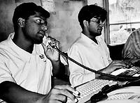 Pakistan, Karachi, 2004. Pakistani citizens give their time to the many ordinary tasks that keep the Edhi Foundation going.