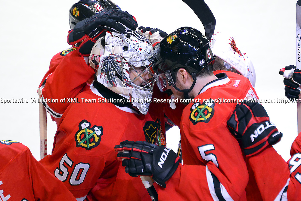 29 December 2014: Chicago Blackhawks Goalie Corey Crawford (50) [3760] celebrates with Chicago Blackhawks Defenceman David Rundblad (5) [7651] and teammates after shutting out the Nashville Predators in a shootout in action during a game between the Nashville Predators and the Chicago Blackhawks at the United Center, in Chicago, IL.